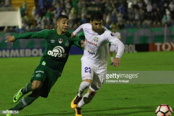 Joao Pedro of Chapecoense and Luciano Guaycochea of Zulia battle during a match between Chapecoense and Zulia as part of Copa Bridgestone...