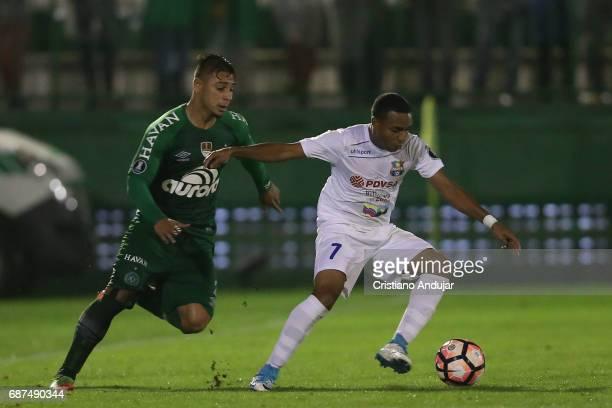 Joao Pedro of Chapecoense battles Yohandry Orozco of Zulia during a match between Chapecoense and Zulia as part of Copa Bridgestone Libertadores at...