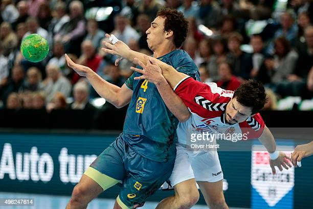 Joao Pedro Silva of Brazil challenges for the ball with Nemanja Zelenovic of Serbia during the Handball Supercup between Brazil and Serbia on...