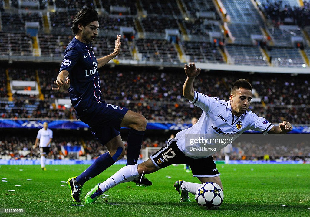 Joao Pereira of Valencia CF duels for the ball with <a gi-track='captionPersonalityLinkClicked' href=/galleries/search?phrase=Javier+Pastore&family=editorial&specificpeople=5857872 ng-click='$event.stopPropagation()'>Javier Pastore</a> of Paris Saint-Germain during the UEFA Champions League Round of 16 first leg match between Valencia CF and Paris St Germain at Estadi de Mestalla on February 12, 2013 in Valencia, Spain.