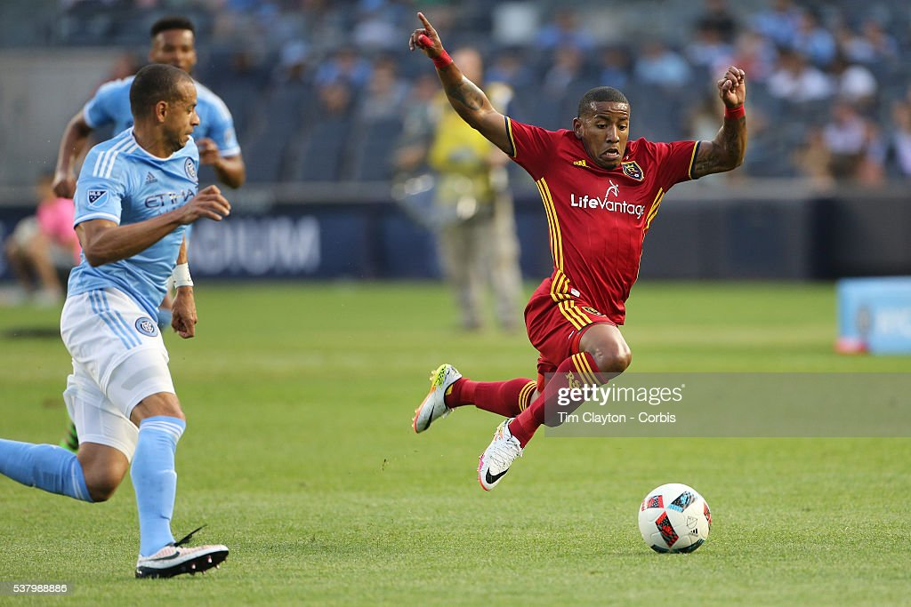 <a gi-track='captionPersonalityLinkClicked' href=/galleries/search?phrase=Joao+Plata&family=editorial&specificpeople=7594186 ng-click='$event.stopPropagation()'>Joao Plata</a> #10 of Real Salt Lake gets to the ball ahead of <a gi-track='captionPersonalityLinkClicked' href=/galleries/search?phrase=Jason+Hernandez+-+American+Soccer+Player&family=editorial&specificpeople=9684404 ng-click='$event.stopPropagation()'>Jason Hernandez</a> #2 of New York City FC during the NYCFC Vs Real Salt Lake regular season MLS game at Yankee Stadium on June 02, 2016 in New York City.