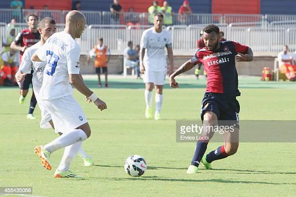 Joao Rangel da Silva Caio of Cagliari compete for the ball with Benalouiane Yohan of Atanta during the Serie A match between Cagliari Calcio and...