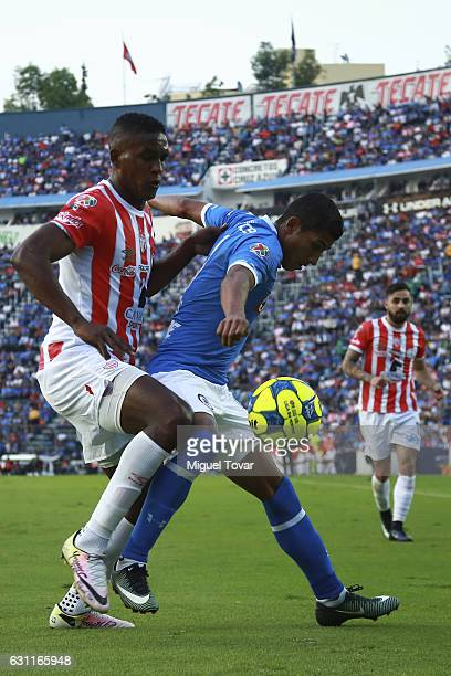 Joao Rojas of Cruz Azul fights for the ball with Brayan Beckeles of Necaxa during the 1st round match between Cruz Azul and Necaxa as par of the...