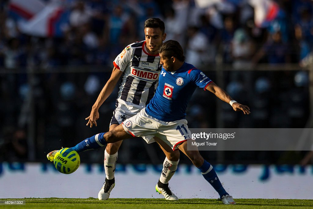 Joao Rojas of Cruz Azul fights for the ball with Severo Meza of Monterrery during a match between Cruz Azul and Monterrey as part of 5th round...