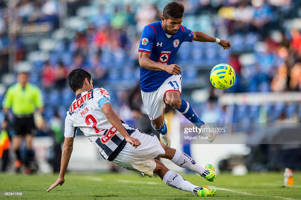 Joao Rojas of Cruz Azul jumps over the slide of Severo Meza of Monterrery during a match between Cruz Azul and Monterrey as part of 5th round...