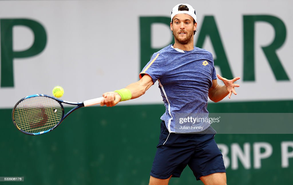 Joao Sousa of Portugal hits a forehand during the Men's Singles first round match against Damir Dzumhur of Bosnia and Herzegovina on day three of the 2016 French Open at Roland Garros on May 24, 2016 in Paris, France.