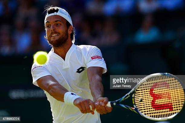 Joao Sousa of Portugal in action in his Gentlemen's Singles first round match against Stanislas Wawrinka of Switzerland during day one of the...