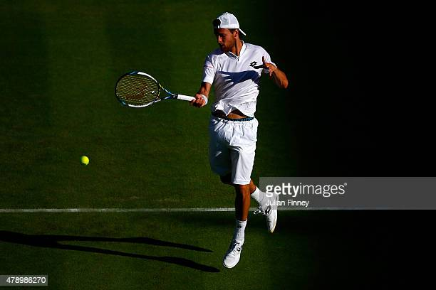 Joao Sousa of Portugal in action in his Gentlemens Singles first round match against Stanislas Wawrinka of Switzerland during day one of the...