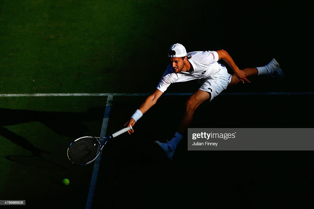 Joao Sousa of Portugal in action in his Gentlemens Singles first round match against Stanislas Wawrinka of Switzerland during day one of the Wimbledon Lawn Tennis Championships at the All England Lawn Tennis and Croquet Club on June 29, 2015 in London, England.