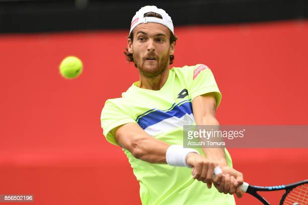 Joao Sousa of Portugal plays a backhand against Bernard Tomic of Australia during day one of the Rakuten Open at Ariake Coliseum on October 2 2017 in...