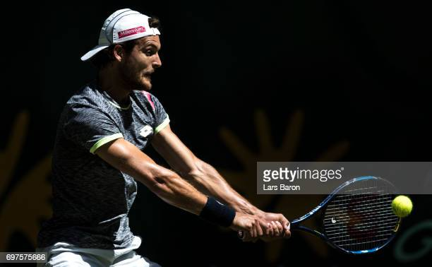 Joao Sousa of Portugal plays a backhand during his match against Philipp Kohlschreiber of Germany on Day 3 of the Gerry Weber Open 2017 at on June 19...