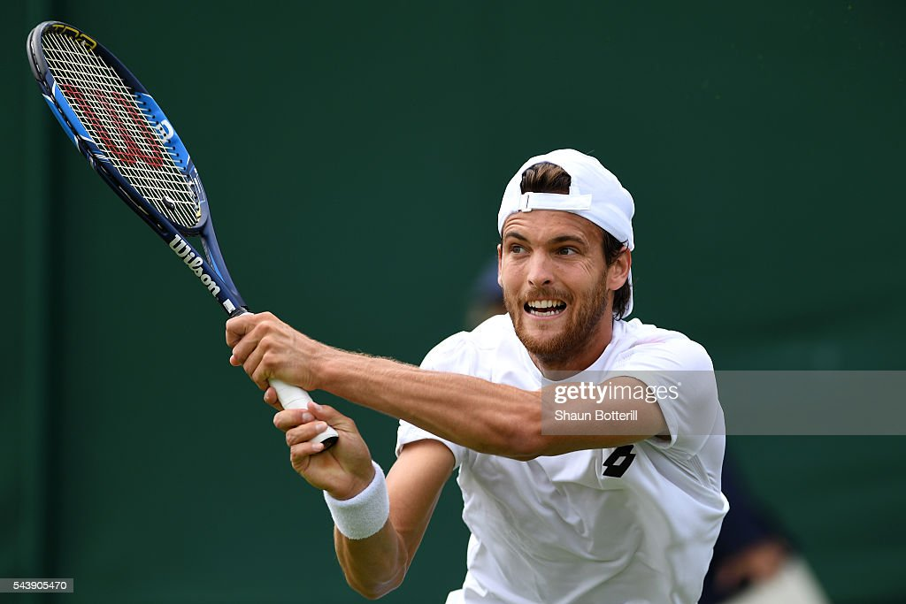 Joao Sousa of Portugal plays a backhand during the Men's Singles second round match against Dennis Novikov of the United States on day four of the Wimbledon Lawn Tennis Championships at the All England Lawn Tennis and Croquet Club on June 30, 2016 in London, England.