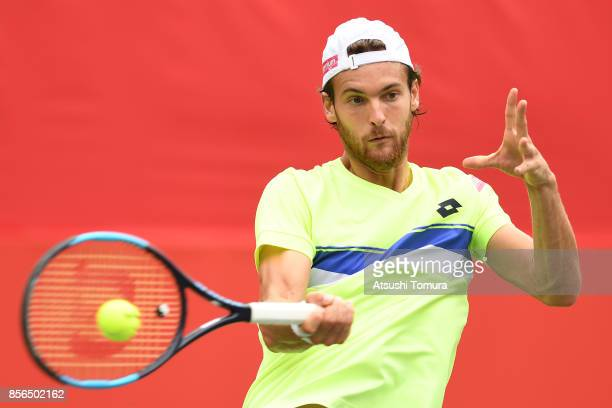 Joao Sousa of Portugal plays a forehand against Bernard Tomic of Australia during day one of the Rakuten Open at Ariake Coliseum on October 2 2017 in...
