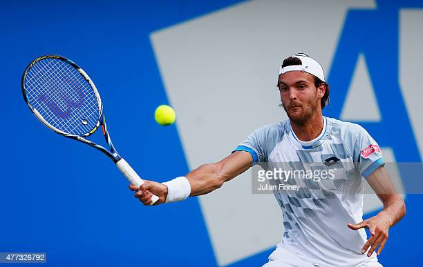 Joao Sousa of Portugal plays a forehand in his men's singles first round match against Feliciano Lopez of Spain during day two of the Aegon...