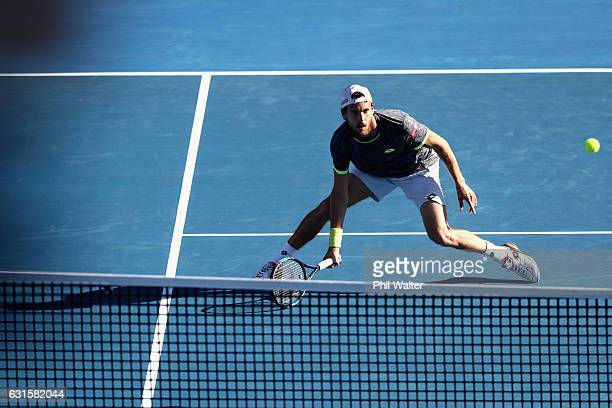 Joao Sousa of Portugal plays a return against Marcos Baghdatis of Cyprus on day 12 of the ASB Classic on January 13 2017 in Auckland New Zealand