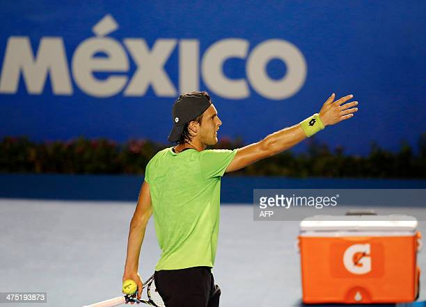 Joao Sousa of Portugal reacts during the Mexico ATP Open men's single tennis match in Acapulco Guerrero state Mexico on February 26 2014 AFP PHOTO/...