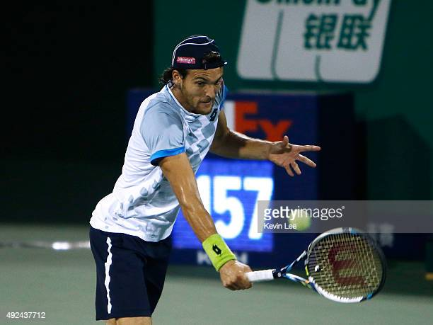 Joao Sousa of Portugal returns a shot against Fabio Fognini of Italy during their men's singles first round match on day 3 of Shanghai Rolex Masters...