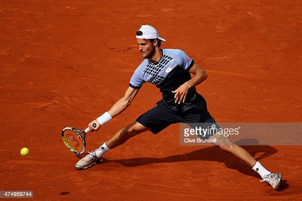 Joao Sousa of Portugal returns a shot in his Men's Singles match against Andy Murray of Great Britain on day five of the 2015 French Open at Roland...
