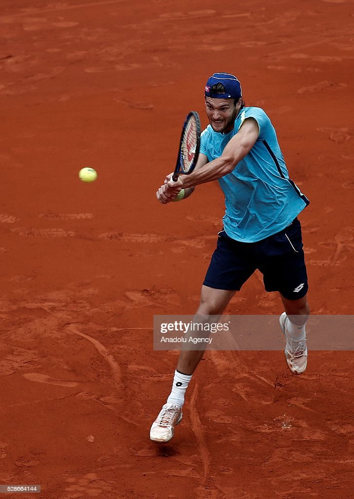 Joao Sousa of Portugal returns the ball to Rafael Nadal of Spain in their quarter final round match during at the Mutua Madrid Open tennis tournament at the Caja Magica in Madrid, Spain on May 06, 2016.
