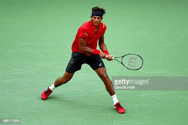 Joao Souza of Brazil against Novak Djokovic of Serbia in their Men's Singles First Round match on Day One of the 2015 US Open at the USTA Billie Jean...