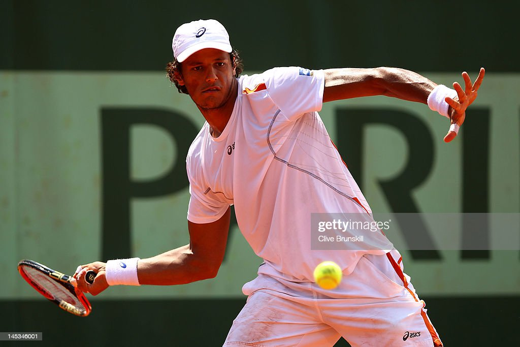 <a gi-track='captionPersonalityLinkClicked' href=/galleries/search?phrase=Joao+Souza+-+Brazilian+Tennis+Player&family=editorial&specificpeople=7935783 ng-click='$event.stopPropagation()'>Joao Souza</a> of Brazil plays a forehand during the men's singles first round match between Cedrik-Marcel Stebe of Germany and <a gi-track='captionPersonalityLinkClicked' href=/galleries/search?phrase=Joao+Souza+-+Brazilian+Tennis+Player&family=editorial&specificpeople=7935783 ng-click='$event.stopPropagation()'>Joao Souza</a> of Brazil on day one of the French Open at Roland Garros on May 27, 2012 in Paris, France.