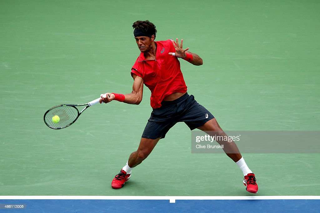 <a gi-track='captionPersonalityLinkClicked' href=/galleries/search?phrase=Joao+Souza+-+Brazilian+Tennis+Player&family=editorial&specificpeople=7935783 ng-click='$event.stopPropagation()'>Joao Souza</a> of Brazil returns a shot against Novak Djokovic of Serbia in their Men's Singles First Round match on Day One of the 2015 US Open at the USTA Billie Jean King National Tennis Center on August 31, 2015 in the Flushing neighborhood of the Queens borough of New York City.
