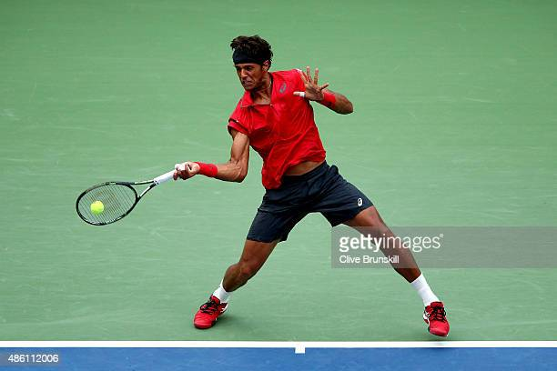 Joao Souza of Brazil returns a shot against Novak Djokovic of Serbia in their Men's Singles First Round match on Day One of the 2015 US Open at the...