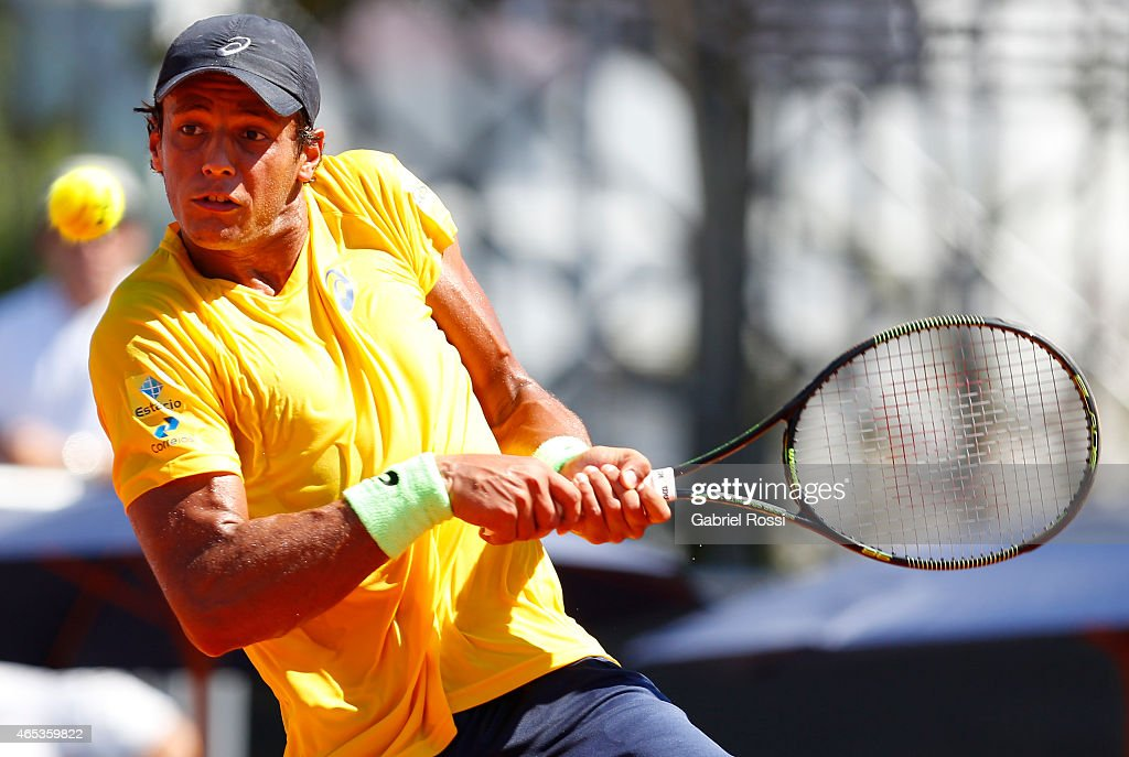 Joa‹o Souza of Brazil takes a backhand shot during a singles match between Carlos Berlocq of Argentina and <a gi-track='captionPersonalityLinkClicked' href=/galleries/search?phrase=Joao+Souza+-+Brazilian+Tennis+Player&family=editorial&specificpeople=7935783 ng-click='$event.stopPropagation()'>Joao Souza</a> of Brazil as part of Davis Cup 2015 match between Argentina and Brazil at Tecnopolis on March 06, 2015 in Villa Martelli, Buenos Aires, Argentina.