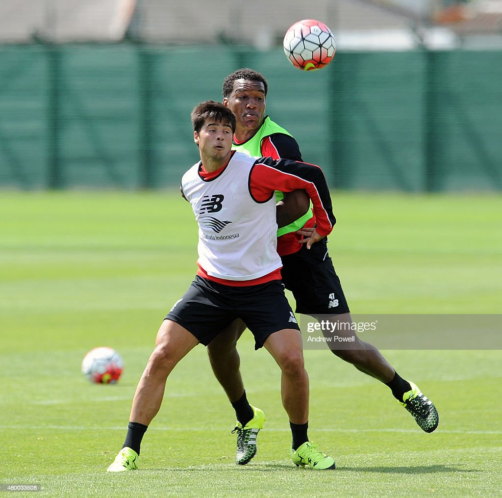 Joao Teixeira and Andre Wisdom of Liverpool during a training session at Melwood Training Ground on July 9, 2015 in Liverpool, England.