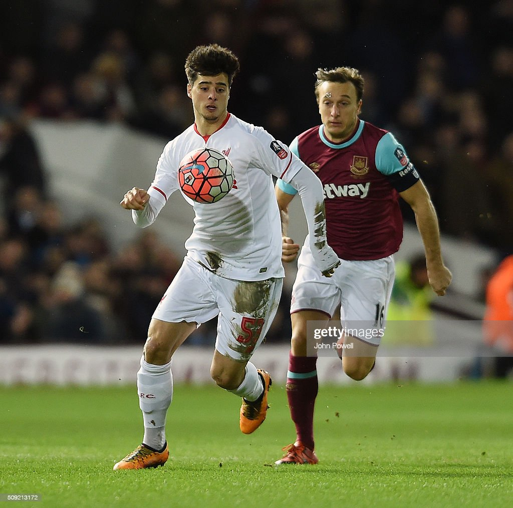 Joao Teixeira of Liverpool competes with <a gi-track='captionPersonalityLinkClicked' href=/galleries/search?phrase=Mark+Noble&family=editorial&specificpeople=844055 ng-click='$event.stopPropagation()'>Mark Noble</a> of West Ham United during the The Emirates FA Cup Fourth Round Replay match between West Ham United and Liverpool at Boleyn Ground on February 9, 2016 in London, England.