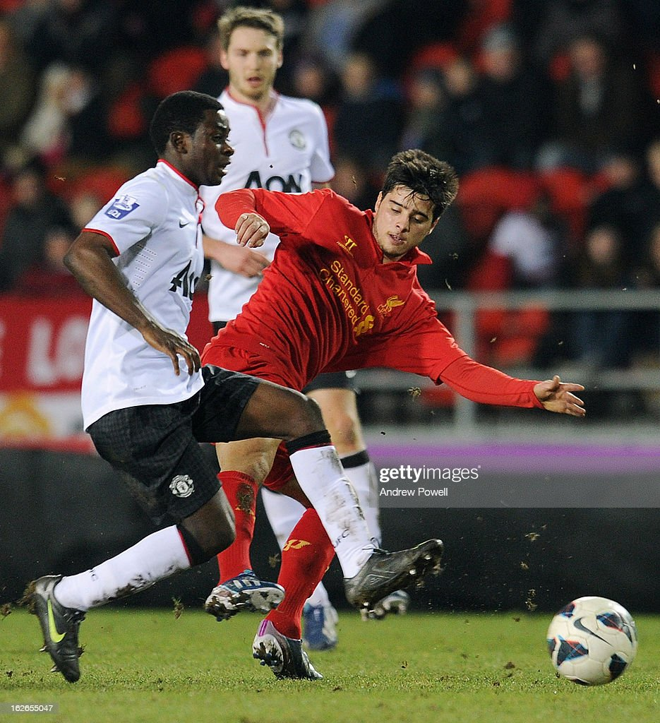 Joao Teixeria of Liverpool competes with Larnell Cole Manchester United Reserves during the Barclays Premier Reserve League match between Liverpool Reserves and Manchester United at Langtree Park on February 25, 2013 in St Helens, England.
