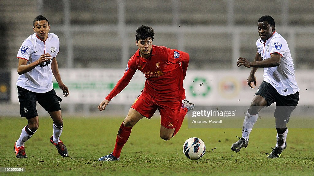 Joao Teixeria of Liverpool competes with Larnell Cole of Manchester United Reserves during the Barclays Premier Reserve League match between Liverpool Reserves and Manchester United at Langtree Park on February 25, 2013 in St Helens, England.