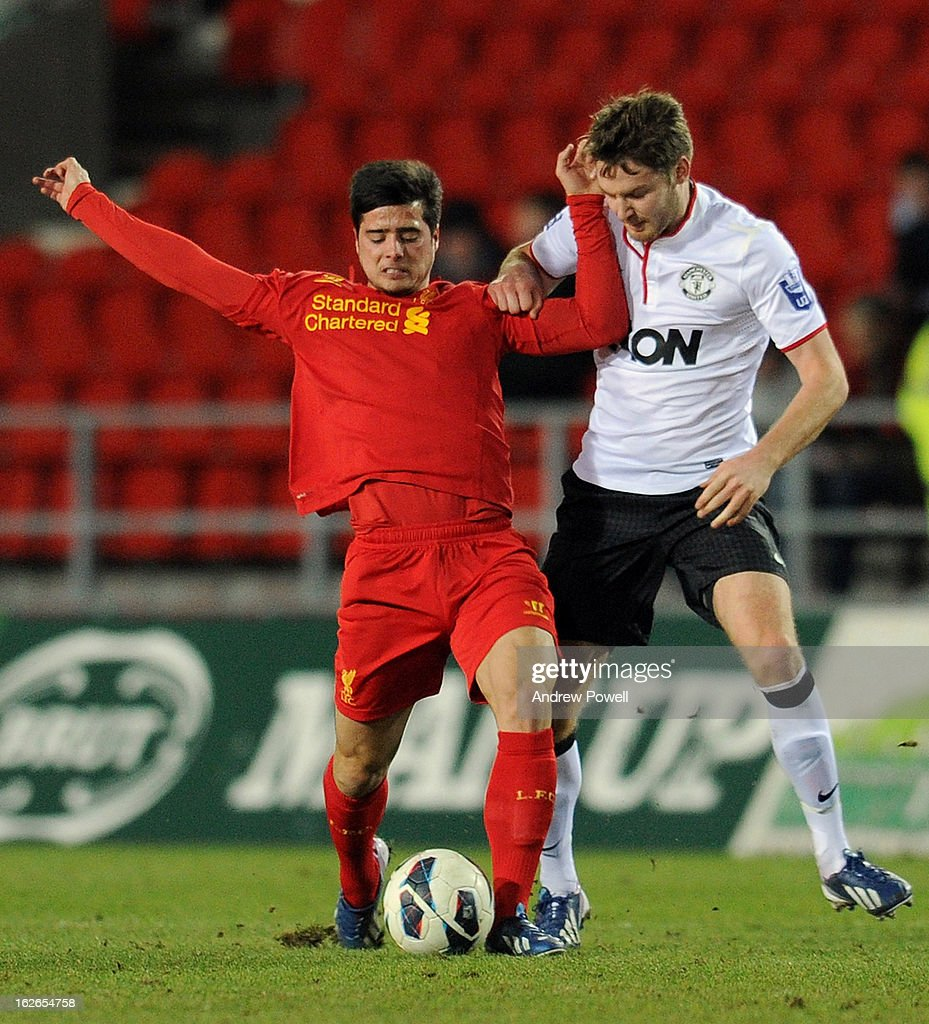 Joao Teixeria of Liverpool competes with Nick Powell of Manchester United Reserves during the Barclays Premier Reserve League match between Liverpool Reserves and Manchester United at Langtree Park on February 25, 2013 in St Helens, England.
