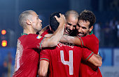 Joao Victor Saraiva of Portugal celebrates with teammates after scoring a goal during the Samsung Beach Soccer Intercontinental Cup Dubai 2014 match...