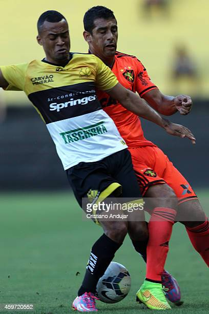 Joao Vitor of Criciuma fight fot the ball with Diego Souza of Sport during a match between Criciuma and Sport as part of Campeonato Brasileiro 2014...