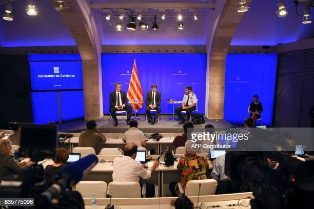 Joaquim Forn the interior minister for the Catalan government President of Catalonia Carles Puigdemont and Josep Lluis Trapero chief of the Catalan...
