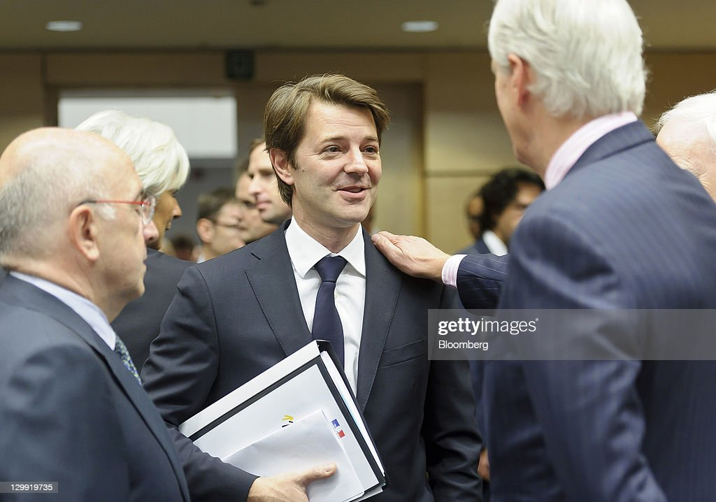 <a gi-track='captionPersonalityLinkClicked' href=/galleries/search?phrase=Joaquin+Almunia&family=editorial&specificpeople=5521769 ng-click='$event.stopPropagation()'>Joaquin Almunia</a>, the competition commissioner for the European Union, left, <a gi-track='captionPersonalityLinkClicked' href=/galleries/search?phrase=Francois+Baroin&family=editorial&specificpeople=552822 ng-click='$event.stopPropagation()'>Francois Baroin</a>, France's finance minister, center, speaks with <a gi-track='captionPersonalityLinkClicked' href=/galleries/search?phrase=Michel+Barnier&family=editorial&specificpeople=220639 ng-click='$event.stopPropagation()'>Michel Barnier</a>, the European Union's internal markets commissioner, ahead of the EcoFin finance ministers meeting at the European Council headquarters in Brussels, Belgium, on Saturday, Oct. 22, 2011. France retreated in a clash with Germany over how to expand the power of Europe's bailout fund as finance ministers entered the second of a six-day marathon to stave off a Greek default and shield banks from the fallout. Photographer: Jock Fistick/Bloomberg via Getty Images