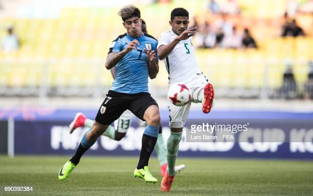 Joaquin Ardaiz of Uruguay challenges Abdulelah Alamri of Saudi Arabia during the FIFA U20 World Cup Korea Republic 2017 Round of 16 match between...