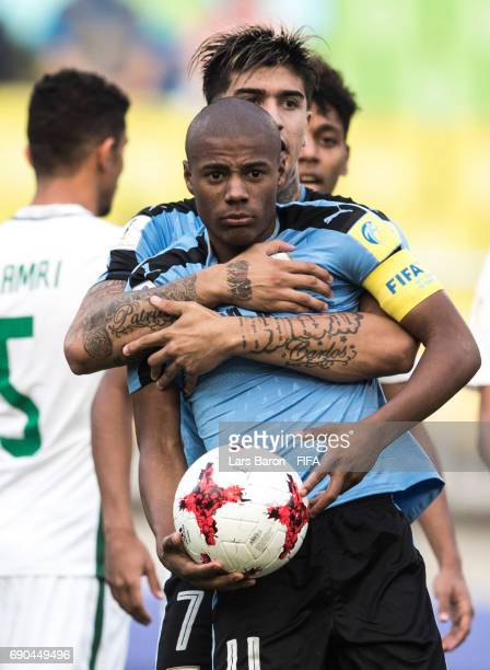 Joaquin Ardaiz of Uruguay hughs Nicolas de la Cruz of Uruguay during the FIFA U20 World Cup Korea Republic 2017 Round of 16 match between Uruguay and...