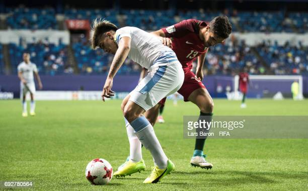 Joaquin Ardaiz of Uruguay is challenged by Jorge Fernandes of Portugal during the FIFA U20 World Cup Korea Republic 2017 Quarter Final match between...
