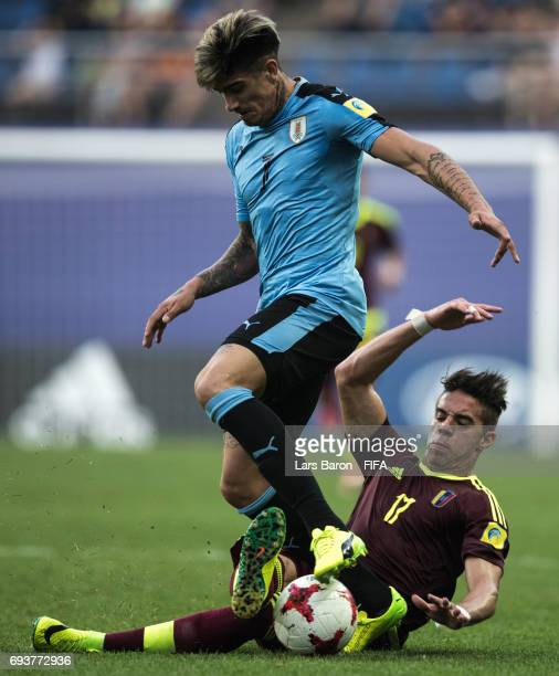 Joaquin Ardaiz of Uruguay is challenged by Josua Mejias of Venezuela during the FIFA U20 World Cup Korea Republic 2017 Semi Final match between...