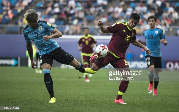 Joaquin Ardaiz of Uruguay is challenged by Ronald Hernandez of Venezuel during the FIFA U20 World Cup Korea Republic 2017 Semi Final match between...