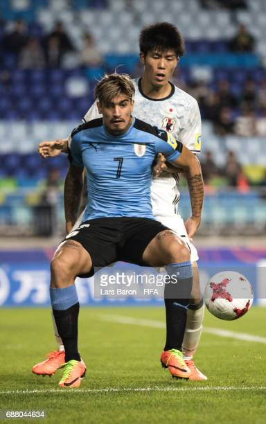 Joaquin Ardaiz of Uruguay is challenged by Takehiro Tomiyasu of Japan during the FIFA U20 World Cup Korea Republic 2017 group D match between Uruguay...