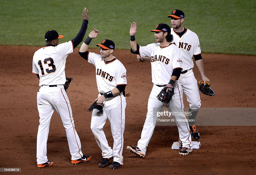 Joaquin Arias #13, Marco Scutaro #19, Brandon Crawford #35 and Brandon Belt #9 of the San Francisco Giants celebrate the Giants 6-1 victory against the St. Louis Cardinals in Game Six of the National League Championship Series at AT&T Park on October 21, 2012 in San Francisco, California.