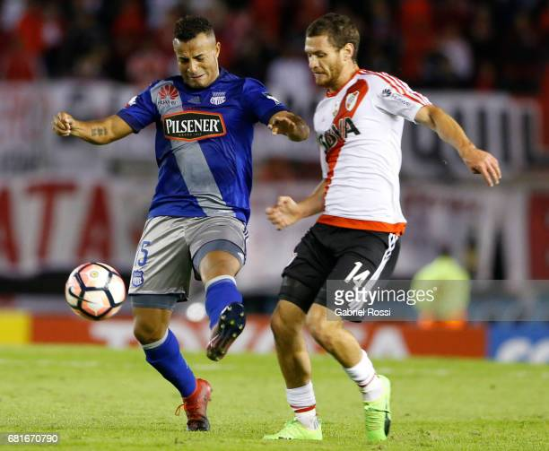 Joaquin Arzura of River Plate and Pedro Quinonez of Emelec compete for the ball during a group stage match between River Plate and Emelec as part of...