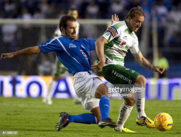 Joaquin Beltran of Cruz Azul vies for the ball with Matias Vuoso of Santos during the first leg match of the Mexican football league final in Mexico...