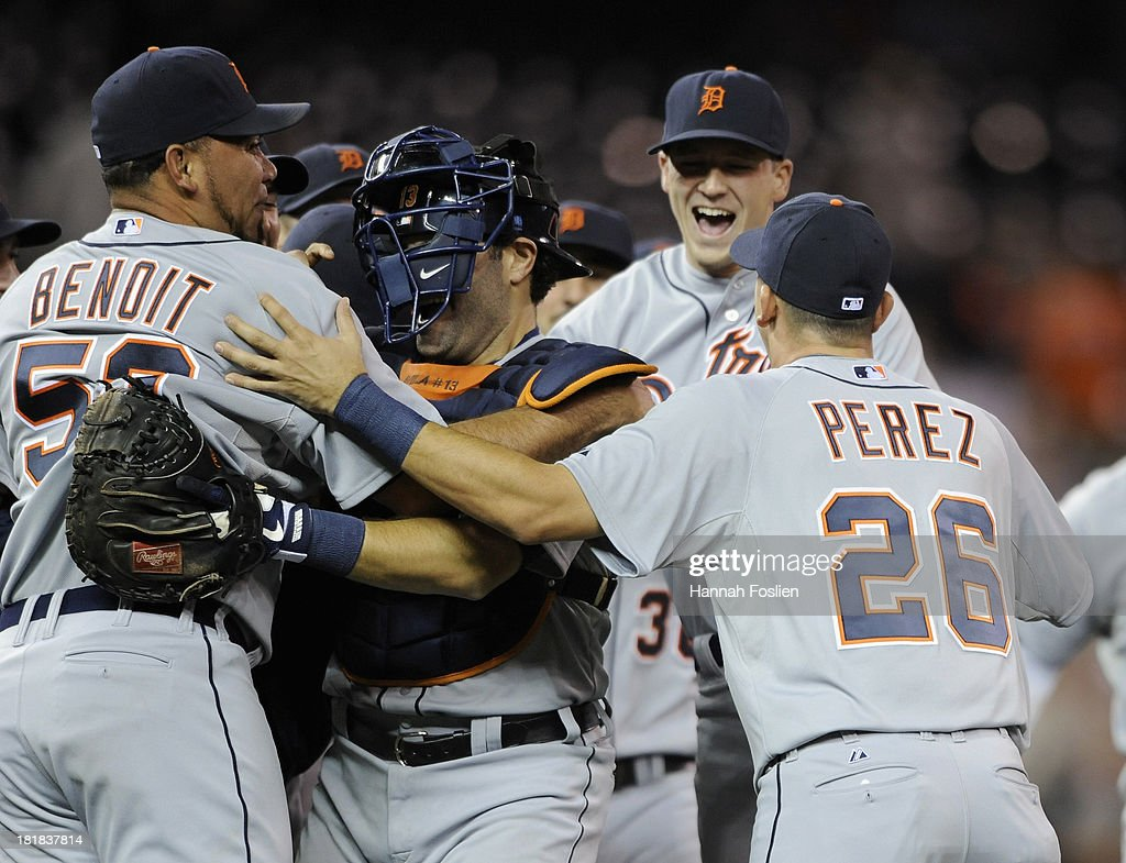 Joaquin Benoit #53, Alex Avila #13 and Hernan Perez #26 of the Detroit Tigers celebrate a win of the game against the Minnesota Twins on September 25, 2013 at Target Field in Minneapolis, Minnesota. The Tigers clinched the American League Central Division title with a 1-0 win over the Twins.