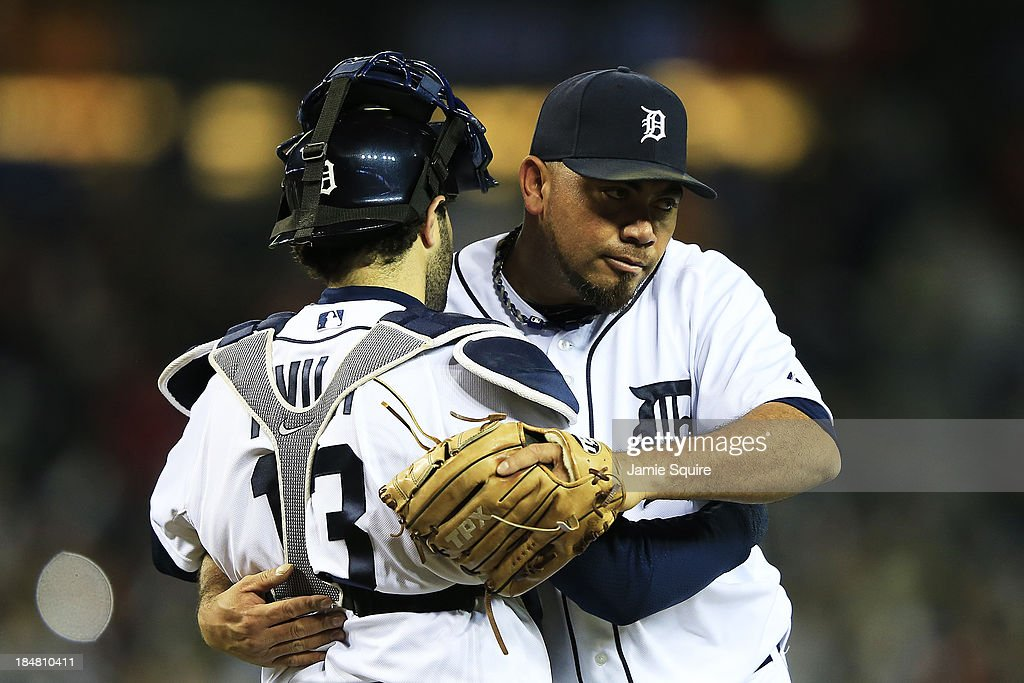 Joaquin Benoit and Alex Avila of the Detroit Tigers celebrate their 7 to 3 win over the Boston Red Sox in Game Four of the American League...