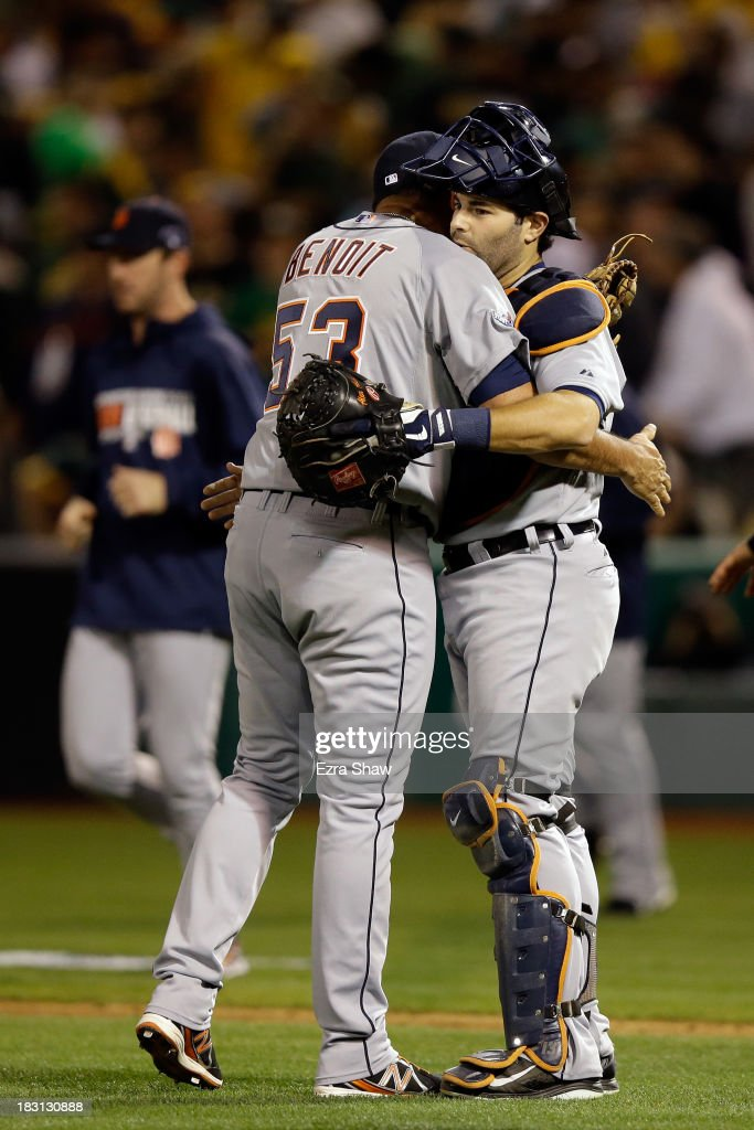 Joaquin Benoit of the Detroit Tigers and Alex Avila celebrate defeating the Oakland Athletics in Game One of the American League Division Series at...