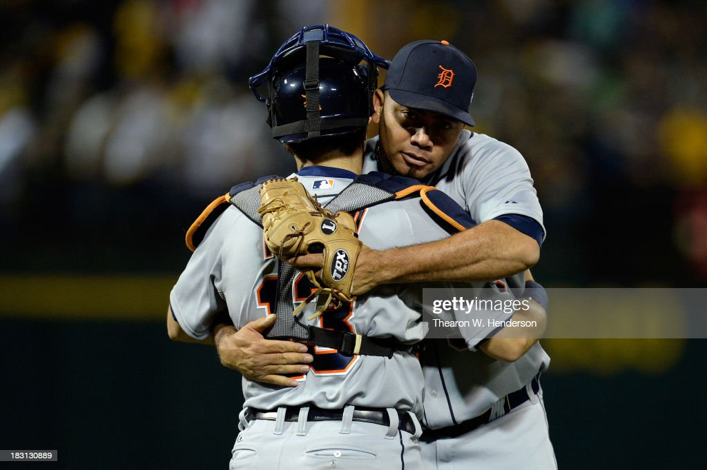 Joaquin Benoit #53 of the Detroit Tigers and <a gi-track='captionPersonalityLinkClicked' href=/galleries/search?phrase=Alex+Avila&family=editorial&specificpeople=5749211 ng-click='$event.stopPropagation()'>Alex Avila</a> #13 celebrate defeating the Oakland Athletics in Game One of the American League Division Series at O.co Coliseum on October 4, 2013 in Oakland, California.